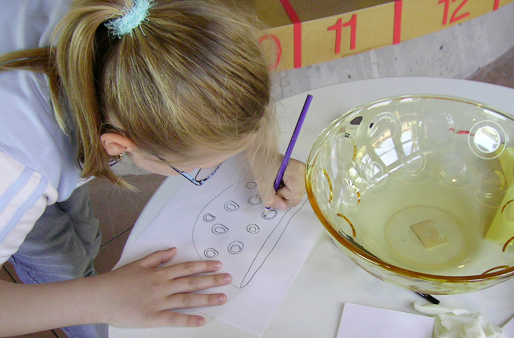 a child drawing a bowl